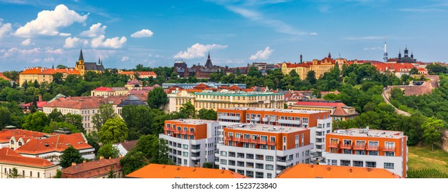 View of Prague Castle over red roof from Vysehrad area at sunset lights, Prague, Czech Republic. Scenic view of Prague city, Prague castle and Petrin tower from Vysehrad overlooking red roofs