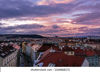 View of Prague with Prague Castle and Petrin hill in the background from Vysehrad in the evening with dramatic clouds. Rooftops. Prague. Czech Republic.