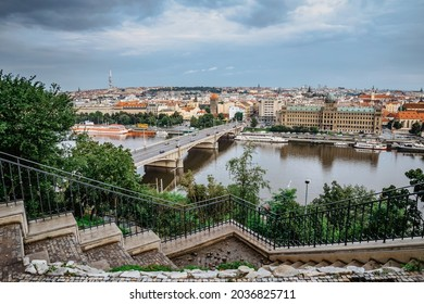 View of Prague from Letna Park,Czech Republic.Prague panorama on cloudy rainy day.Amazing European cityscape.Red roofs,TV tower,Vltava river,historical houses.Travel urban scene.Beautiful sightseeing - Shutterstock ID 2036825711