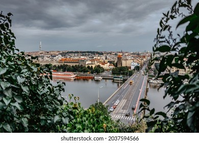 View of Prague from Letna Park,Czech Republic.Prague panorama on cloudy rainy day.Amazing European cityscape.TV tower,bridge over Vltava river,cars in motion,historical houses.Travel urban scene. - Shutterstock ID 2037594566
