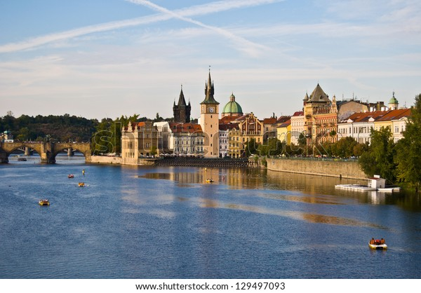 view of Prague and the Vltava  in the evening