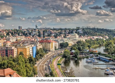 View of Prague from the Vltava river: house, trees, buildings and historical palaces