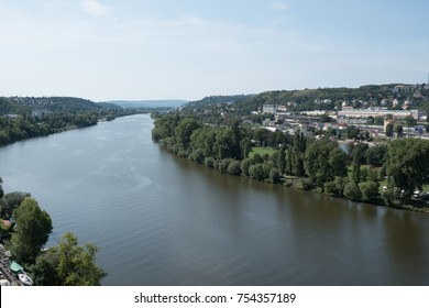 View of Prague and the Vltava River from Vseyhrad. Looking down on the Vltava River as it curves along a quaint European town from above on a summer day.