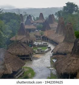 View of Prai Ijing traditional village on a rainy overcast day, Waikabubak, Sumba island, East Nusa Tenggara, Indonesia