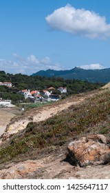 View from praia das maçãs beach in Portugal of a castle on the top of the mountain. Taken on a sunny summer day.