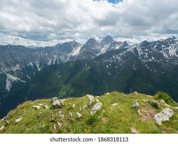 view from Pramarnspitze saddle on snow-capped moutain panorama at Stubai hiking trail, Stubai Hohenweg, Alpine landscape of Tyrol Alps, Austria. Summer blue sky, white clouds