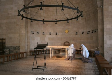 View of praying nuns inside The Church of the Multiplication of the Loaves and the Fishes, Tabgha, Israel