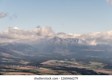 view from Predna Poludnica hill in Nizke Tatry mountains during nice autumn day with blue sky and clouds