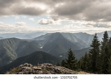 view from Predna Poludnica hill in Nizke Tatry mountains in Slovakia during autumn day with blue sky and clouds