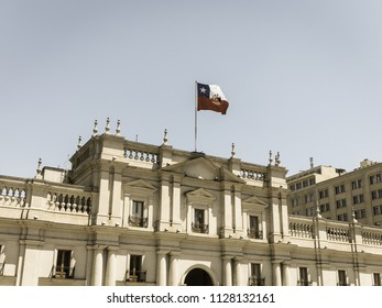 View of the presidential palace, known as La Moneda, in Santiago, Chile. This palace was bombed in the coup of 1973. Image with vintage and yesteryear effect