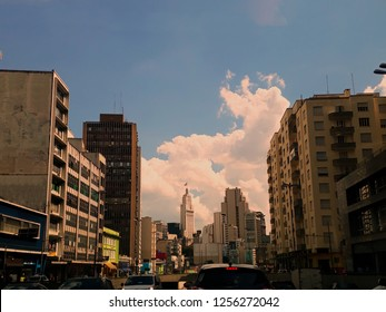 view of the Prestes Maia avenue, with old downtown buildings in the background and Banespa building with Sao Paulo state flag hoisted at the top, SP, Brazil - Shutterstock ID 1256272042