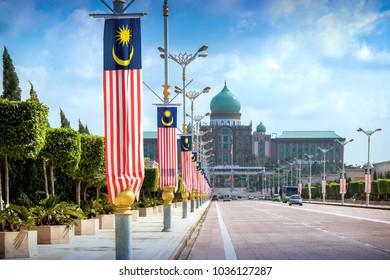 View of the Prime Minister's office from the Seri Gemilang Bridge in the planned city of Putrajaya south of Kuala Lumpur with malaysian flags all along the road