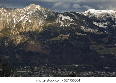 View of the Principality of Liechtenstein and Vaduz in the west, with a height of Switzerland. The evening sun illuminates the tops of the mountains.