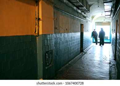 View of prison hallway, prison guards standing at the far end of it. Press tour for mass-media organized by Lukyanovskaya detention facility Directorate. February 21, 2018. Kiev, Ukraine
