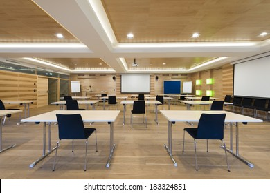 view to projector screen in wooden conference room