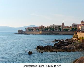 View of the promenade and the old walls of alghero. Alghero, Sardinia, Italy.