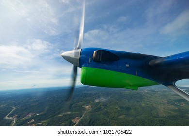 View of propeller turbo prop aircraft in flight from Miri to Bario which take about 1 hour flight time.