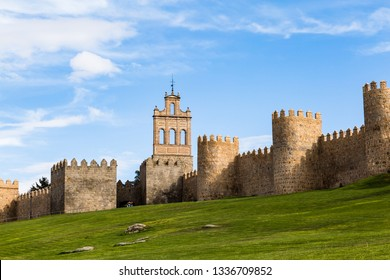 View of Puerta de Carmen and the medieval city walls surrounding the city of Avila, Spain. Called the Town of Stones and Saints, Avila is a UNESCO World Heritage Site
