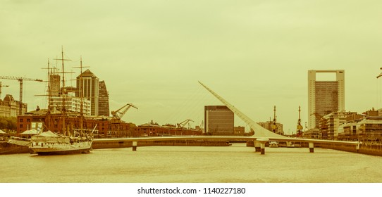 View of Puerto Madero, with the frigate Sarmiento and the woman bridge. Puerto Madero, now converted into a tourist and office area. Vintage and yesteryear effect