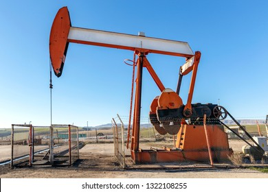View of the pumpjack in the oil well. A pump jack is a device used in the petroleum industry to extract crude oil from an oilfield.