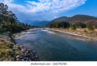 View of the Punakha River flowing through the Punakha valley in Bhutan.