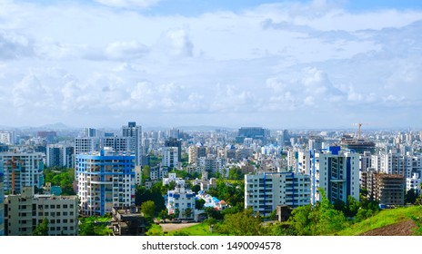 View of Pune in rainy season, Cityscape Skyline, buildings holdings, Signboards, and banners, Pune, Maharashtra, India - 24 August 2019