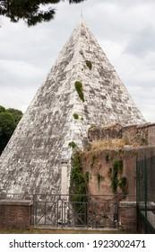 A view of Pyramid of Cestius in Piazza della Piramide in Rome - Shutterstock ID 1923002471