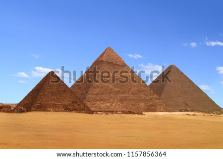 A view of the pyramids at Giza from the plateau to the south of the complex. From left to right, the three largest are: the Pyramid of Menkaure, the Pyramid of Khafre and the Great Pyramid of Khufu.