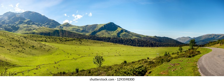 a view of Pyrenees mountains with blue sky