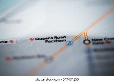 View of Queens Road Peckham station on a London underground map. (vignette)