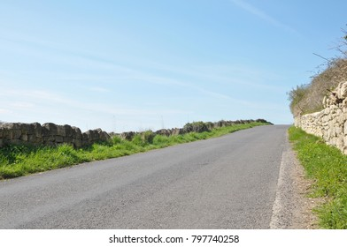 View of Quiet Country Road Running through Farmland