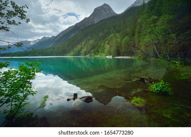 View of the quiet water of Lake Antholz in South Tirol, Italy