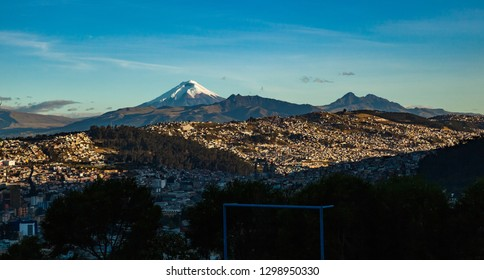 View from Quito to Cotopaxi, Pasochoa and Rumiñahui at sunset