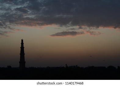 A view of Qutub Minar on a cloudy day in Delhi, India