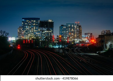 View of a rail yard and modern buildings at night, from the Bathurst Street Bridge in Toronto, Ontario.