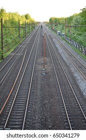 View at railroad tracks and power lines from bridge in Albertslund, Denmark looking towards Taastrup taken in May 2017