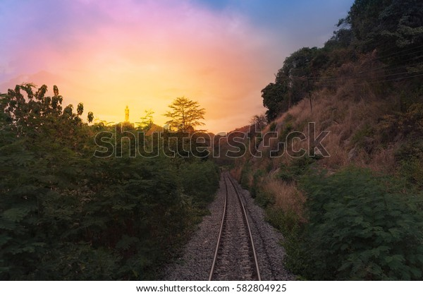 view of the railway track on a sunset