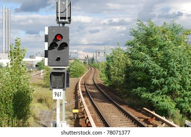 View of a railway track and a traffic light