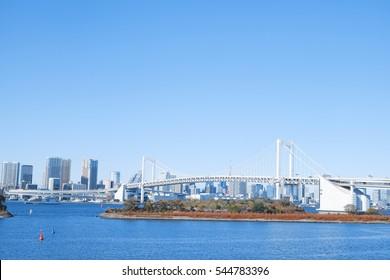 View of the rainbow bridge from Odaiba marina park , Odaiba bridge , Odaiba Tokyo