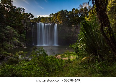 View of Rainbow Falls Kerikeri New Zealand from Track along River Surrounded by Bush Horizontal