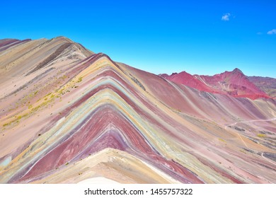 View of the Rainbow mountain near the Vilcanota mountain range in the Cusco region, Peru