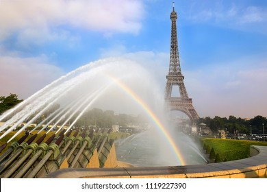 view with rainbow over the Eiffel Tower and Fountain of Warsaw from Trocadero gardens , Paris, France
