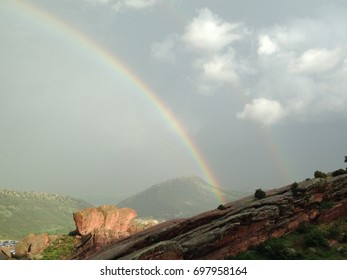 View of rainbow in sky from mountain