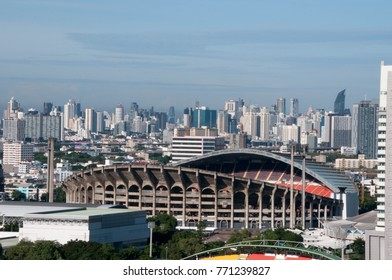 view of Rajamanggala national stadium with Bangkok downtown background