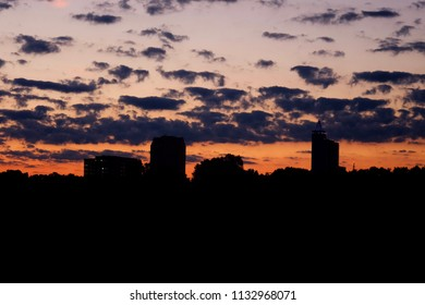 View of the Raleigh skyline at twilight as seen from Dorothea Dix Park