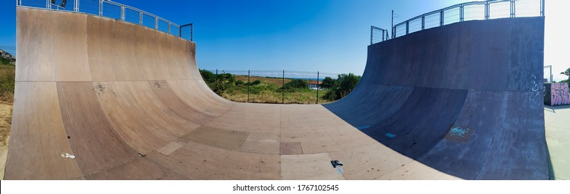 view of a ramp in the skatepark for skateboards and in line skates.skatepark background. half pipe ramp in the skatepark