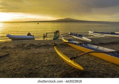 View to Rangitoto Island and Waka Boats at Takapuna Beach during Sunrise Time, Auckland - New Zealand