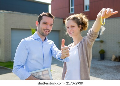 View of a Real estate agent handing over keys