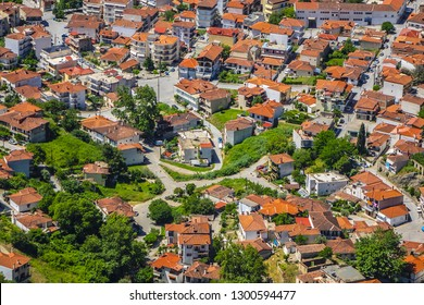 View of the red roofs of the Kalambaka town from the Meteora rocks, Greece.