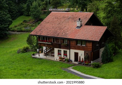 View of a red wooden chalet farm house situated at the alpine village of Hasliberg ,Switzerland.
